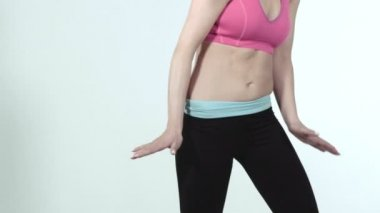 Portrait of a sporty young woman dancing over white background, slow motion. — Stock Video