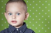 Surprised a little boy looking at the camera — Stockfoto