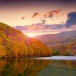 Autumn landscape in the mountain lake — Stock Photo #53808367