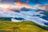 Beautiful foggy sunrise in the Italian Alps. Dolomites — Stock Photo