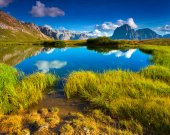 Sassolungo mountain range at sunny summer day. — Stock Photo