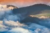 Foggy summer sunrise in the Italian Alps. — Stock Photo
