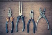 Shelf with a set of old pliers — Stock Photo