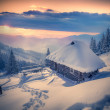 Forester's hut covered with snow in the mountains at sunrise. — Stock Photo #59395451