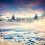 Beautiful winter sunrise in mountain village. — Stock Photo #60910951