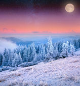 Rising moon over winter mountains. — Stock Photo