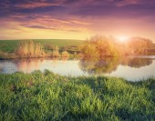 Colorful spring sunrise on the fishing pond. — Stock Photo