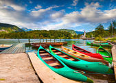 Bohinj Lake with boats and Church of St John the Baptist — Stock Photo