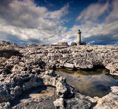 Old lighthouse on the Murro di Porco cape — Stock Photo