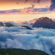 Постер, плакат: Sunrise in foggy Val di Fassa valley