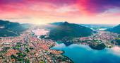 Sunrise on the city and lake Lecco — Stock Photo