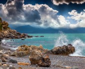 Stormy weather on the volcanic beach  — Stock Photo