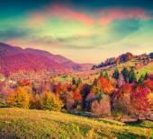 Colorful autumn sunset in mountain village — Stock Photo