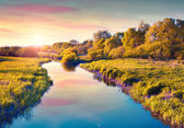 Colorful summer sunrise on the river. — Stock Photo