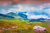 Foggy sunny morning on the Val Gardena valley — Stock Photo