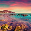 Colorful spring sunset from the Giallonardo beach — Stock Photo #79909192