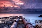 Two pipes on the beach — Stock Photo