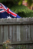 Australian flag behind fence — Stock Photo
