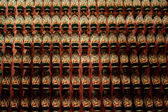 Rows of buddha statues — Stock Photo