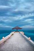 Pier after a monsoon in the maldives — Stock Photo