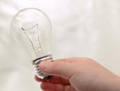 Light bulb in hand — Stock Photo