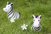 Zebra doll on the grass — Stock Photo