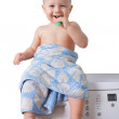 Cute toddler brushing his teeth — Stock Photo #63696747