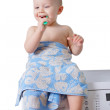 Cute toddler brushing his teeth — Stock Photo #63696767