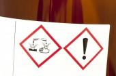 Corrosive and Harmful symbols on bottle — Stock Photo