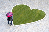 Couple in love under umbrella — Stock Photo