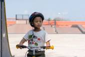 Little boy wearing helmets ridding bike . — Fotografia Stock