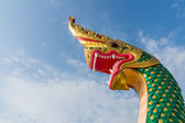 Serpent king or king of naga statue in thai temple on blue sky b — Stock Photo