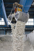 Crane picking up materials — Stock Photo
