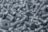 Bolts as background — Stock Photo