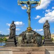 Crucifixion, statue with Hebrew lettering in Charles Bridge Prague, Czech Republic — Stock Photo #58868949