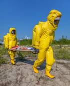 Mans in protective hazmat suit, blue sky — Stock Photo