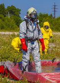 Hazmat team members have been wearing protective suits to protect them from hazardous materials — Stock Photo
