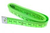 白い背景の上の緑のテープ メジャー — ストック写真