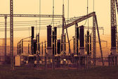 Part of high-voltage substation with switches and disconnectors, sunset — Stock Photo