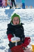 Child playing on the snow — Stock Photo