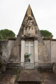 Monumental tomb with statue of madonna — Stock Photo
