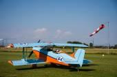 Light aircraft, modern biplane orange and blue — Stock Photo