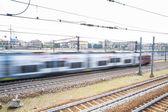 Detail blurred picture train on railway interchange — Stock Photo