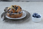 Fresh Blueberry Muffin on Rustic Burlap Background — Stock Photo