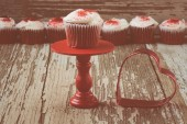 Cupcake on stand with rustic backgound — Stock Photo