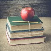 Books and apple  on retro background with Instagram Style Filter — Stockfoto