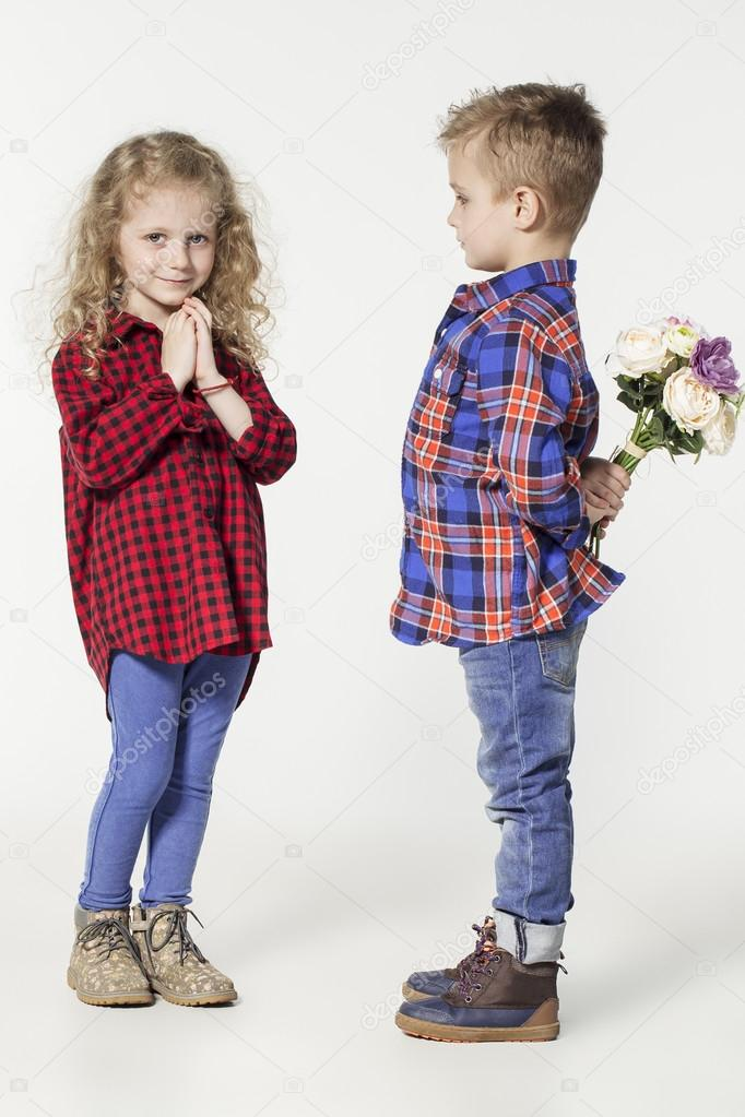 funny lovely children fashionable little boy and girl in