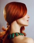 Emotive portrait of a fashionable model with red (ginger) curly hair and natural make-up — Stock Photo