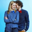 Portrait of gorgeous blond fashion man and woman in jeans shirt and funny bow tie, posing on blue background. Perfect skin and hairdo. Vogue style. Studio shot. Lifestyle concept — Stock Photo #66081089