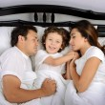Family in the bedroom — Stock Photo #57187603